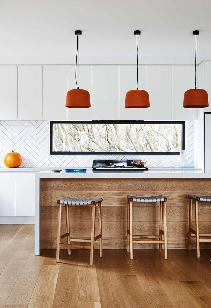 """**Kitchen** """"I love to cook and chat, so the bar stools get a workout,"""" says Brooke. Taking the place of a traditional splashback, the picture window allows the view beyond to become part of the kitchen decor. Masia Blanco tiles from [National Tiles](https://www.nationaltiles.com.au/