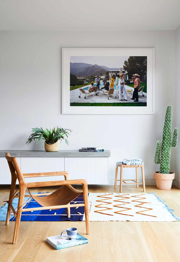 """**Study** This workspace is just beyond the living room, and sometimes used by the kids to play games. Fatin rug from [Lrnce](https://lrnce.com/