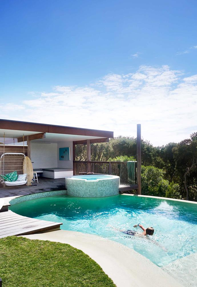 **Pool** Ziggy in the kidney-shaped pool, neatly moulded into its surroundings. The pool house has a fully equipped kitchen for breezy entertaining. Ironbark feature posts and decking plus Corten steel cladding stand up well in all weather conditions.