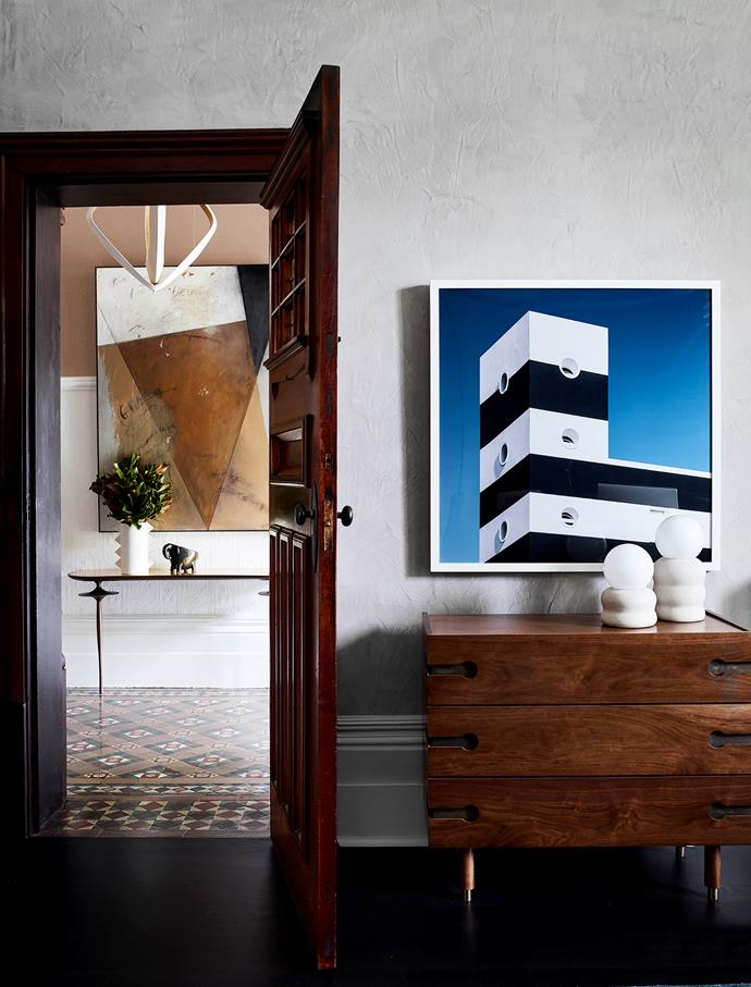 Table lamps from Fenton & Fenton in the study stand on the 'Niguel' dresser from Lawson-Fenning. Senigallia framed photograph by Andrea Sopranzi from The Cool Hunter. Looking through to the entrance hall and the artwork by Brian Hagiwara.