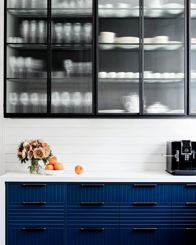 """Recessed leather MadeMeasure pulls on custom cabinetry. """"Horizontal boards add a contemporary detail within the historic house,"""" says Thomas."""