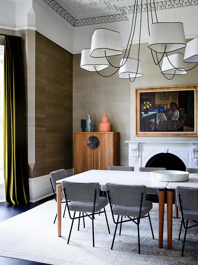 Etching striking lines in the formal dining room, 'Lustre 6 Grand Nuage' chandelier by Designheure. 'Halo' storage cabinet from Zuster topped with an assortment of clay vases by Paola Paronetto from Fanuli. 'Tavolo 95' dining table by De Padova and Arflex 'Elettra' chairs from Poliform. Yorkeys Knob by Ray Crooke from Philip Bacon Galleries.