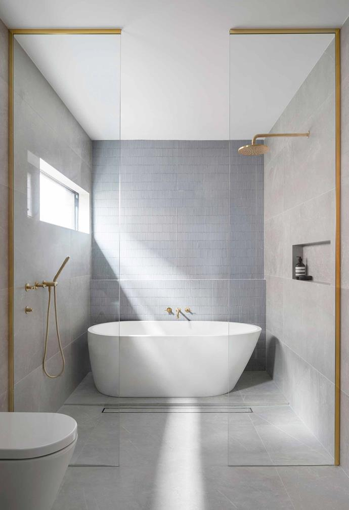 "Brushed-brass fittings are a luxurious highlight in the relaxed bathroom in [Bec and George's renovated family home](https://www.homestolove.com.au/bec-and-george-home-renovation-20669|target=""_blank""). The soft grey palette forms the perfect neutral backdrop."
