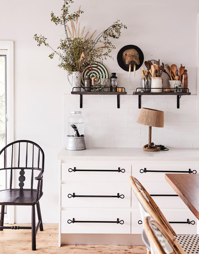 Sibella retained all the existing kitchen joinery but gave it a fresh look with Collar Rack drawer pulls and Palmer shelves, both from The Society Inc. Rainbow black walnut armchair, Sawkille Co. Shipwright rope lamp, The Society Inc. Papier-mâché walrus trophy, a special find.