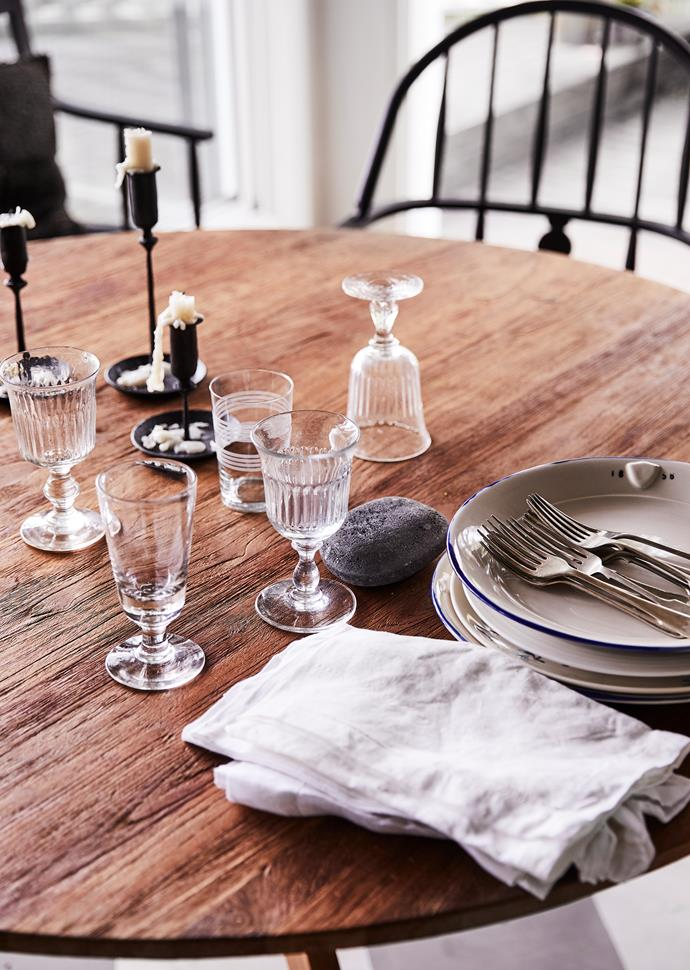 """This rustic table has had many lives,"" says Sibella. Lineage candleholders, The Society Inc. Vintage tableware collected over many years."
