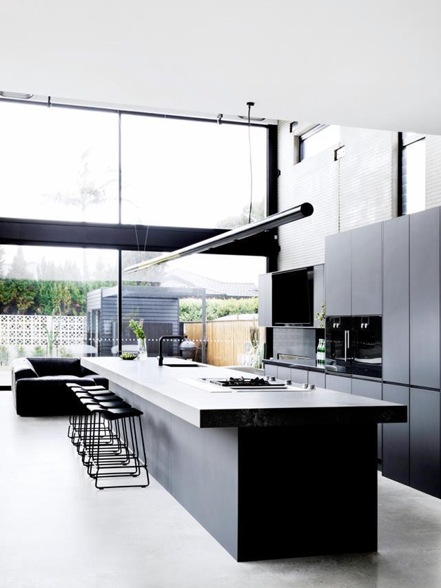 "Guy and Jules Sebastian's' vision for their kitchen was for a sleek, open-plan, crowd-pleasing [entertainer's kitchen](https://www.homestolove.com.au/guy-sebastian-kitchen-20668|target=""_blank"") where they could host hordes of family and friends. On their wish list: abundant storage, a butler's pantry to hide mess, a monochromatic palette and an urban-industrial vibe - All of which was achieved thanks to Freedom Kitchens."