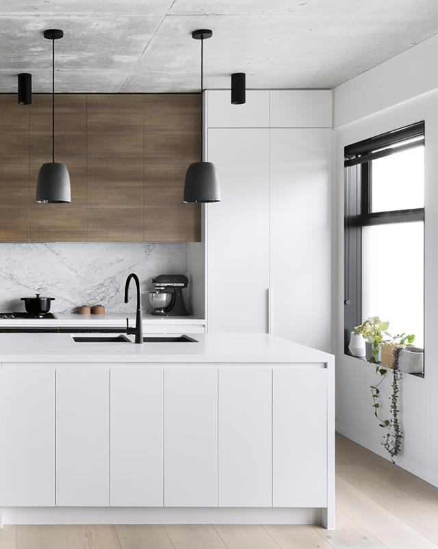 "When the developers of a boutique apartment complex in Melbourne's inner east asked Mikayla Rose from Heartly to design the interiors, they briefed her to create a [kitchen scheme](https://www.homestolove.com.au/white-and-timber-kitchen-19832|target=""_blank"") that was sophisticated, enduring and practical. Mikayla combined a predominantly white palette with natural stone and timber to create a space that is both modern and classic."