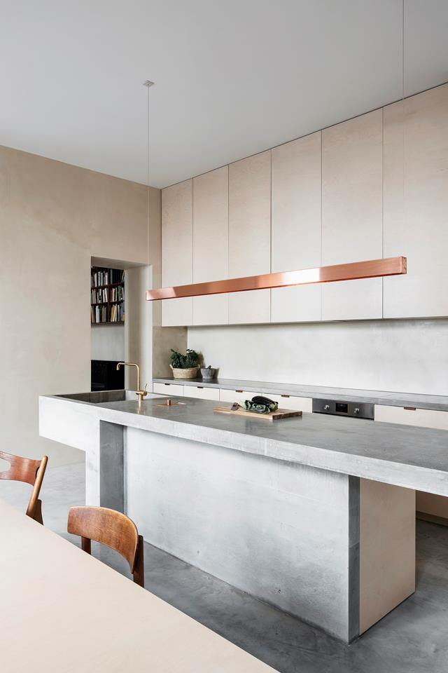 "Capturing serenity with a neutral palette of grey, beige and white, design studio Mar Plus Ask created interest in this [minimalist home](https://www.homestolove.com.au/neutral-home-19204|target=""_blank"") with the use of textural elements in natural tones, such as copper, brass, leather, oak and even a hint of marble. Referred to fondly as the ""dinosaur"", the 3.6m concrete kitchen island was cast directly on site."