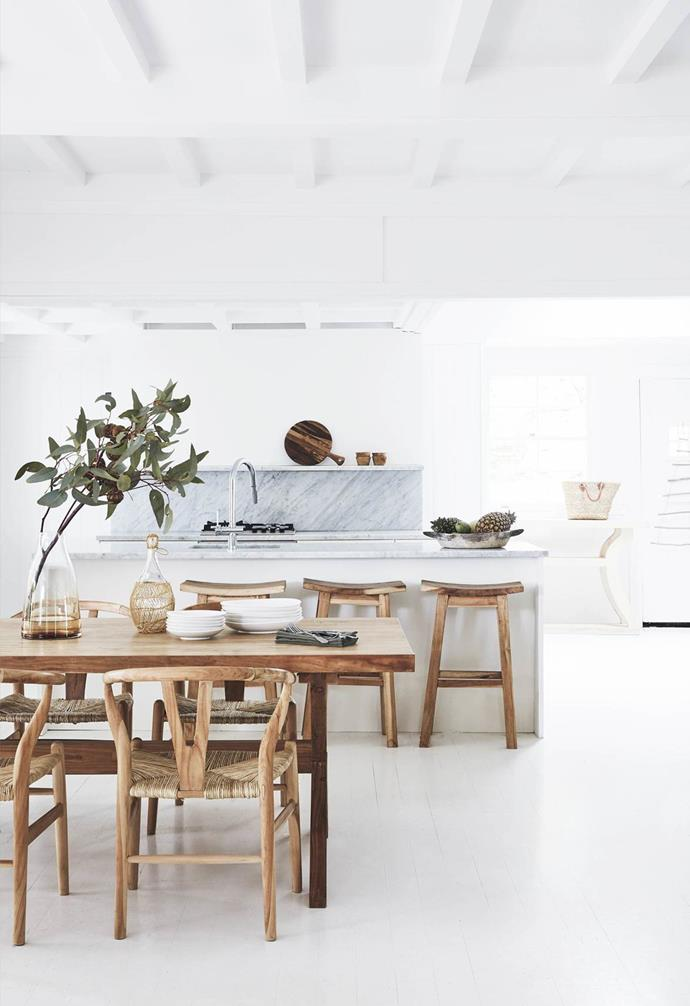 "White is a classic kitchen colour palette for a reason, and this renovated [1920s Palm Beach holiday home](https://www.homestolove.com.au/renovated-1920s-palm-beach-christmas-holiday-home-19235|target=""_blank"") makes the most of it. White kitchen cabinetry is paired with marble benchtops and splashback which add depth to this all-white home, and timber furniture warms the space up. ."