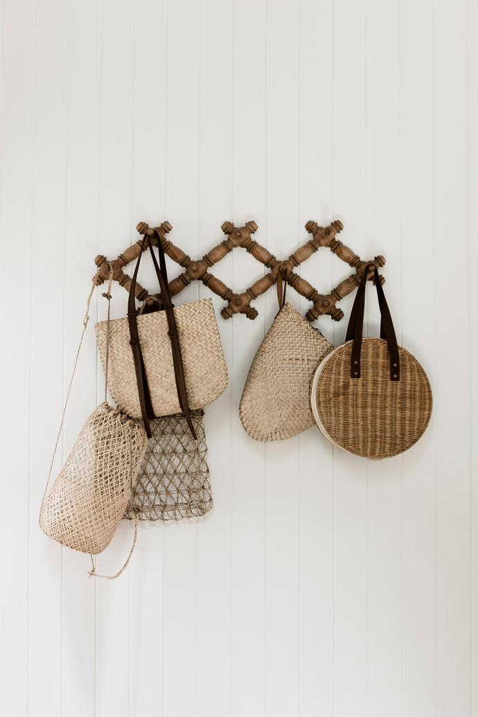 **Baskets, bags and hats:** Not only is it extremely handy to have bags, baskets or your favourite straw hat on hand at the entry to your home, these everyday items can create a decorative display when grouped together.