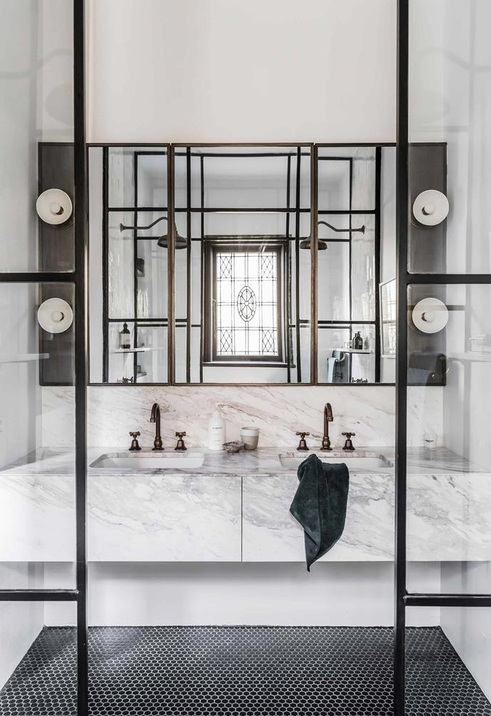 "**Ensuite** Reflected in the mirrored cabinets is the luxurious double shower. Jillian bought the 1920s leadlight window from an antique store. Vanity, [Euro Marble](https://euromarble.com.au/|target=""_blank""