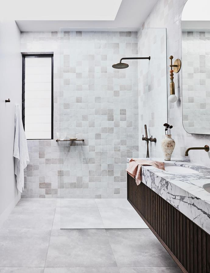 Flooring: 'Marchese' in Naturale from Barefoot Living. Showerhead/tapware: Brodware 'Yokato' in Statue Bronze from Candana. Towel rail/shelf/hooks Brodware 'Yokato' in Statue Bronze from Candana.