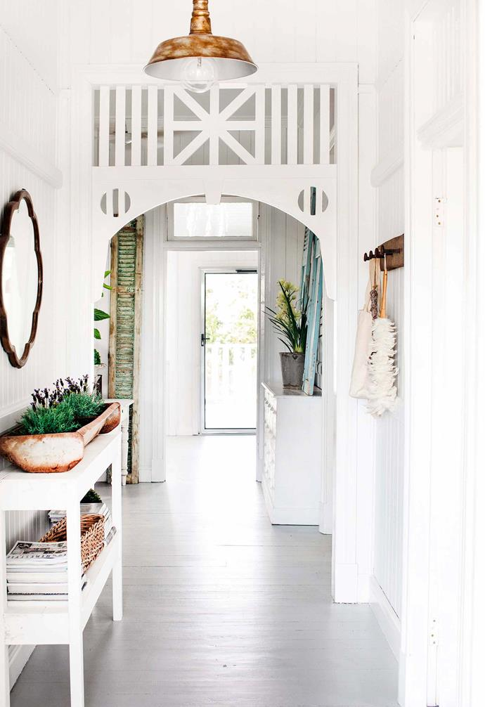 "This [charming Queenslander in Bundaberg](https://www.homestolove.com.au/queenslander-white-interior-colour-scheme-19786|target=""_blank"") was given an all-white revamp that amplifies the ample natural light throughout."