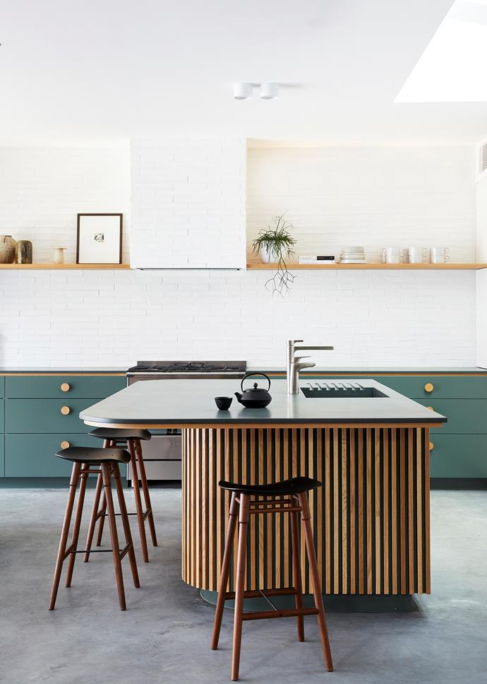 "The kitchen in this [Byron Bay villa](https://www.homestolove.com.au/barefoot-bay-villa-byron-bay-21018|target=""_blank"") is where Melissa Bonney of The Designory implemented brave ideas that clients might shy away from. The standout area of the cooking zone is the green and timber combination carried through joinery and island."