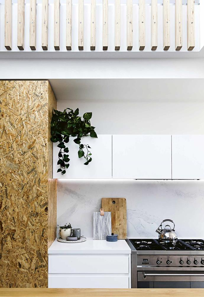 """Downstairs, the kitchen is at the heart of the home connecting to both living areas. It features an especially large American oak [kitchen island benchtop](https://www.homestolove.com.au/kitchen-inspiration-13-of-the-best-island-benches-17943