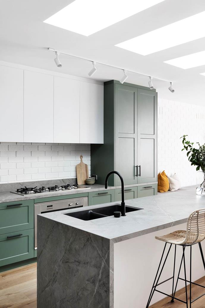"Sage green cabinets painted in Dulux 'Spiralina' and white-painted brick walls create a fresh yet welcoming feel in this [family home's](https://www.homestolove.com.au/bec-and-george-home-renovation-20669|target=""_blank"") kitchen."