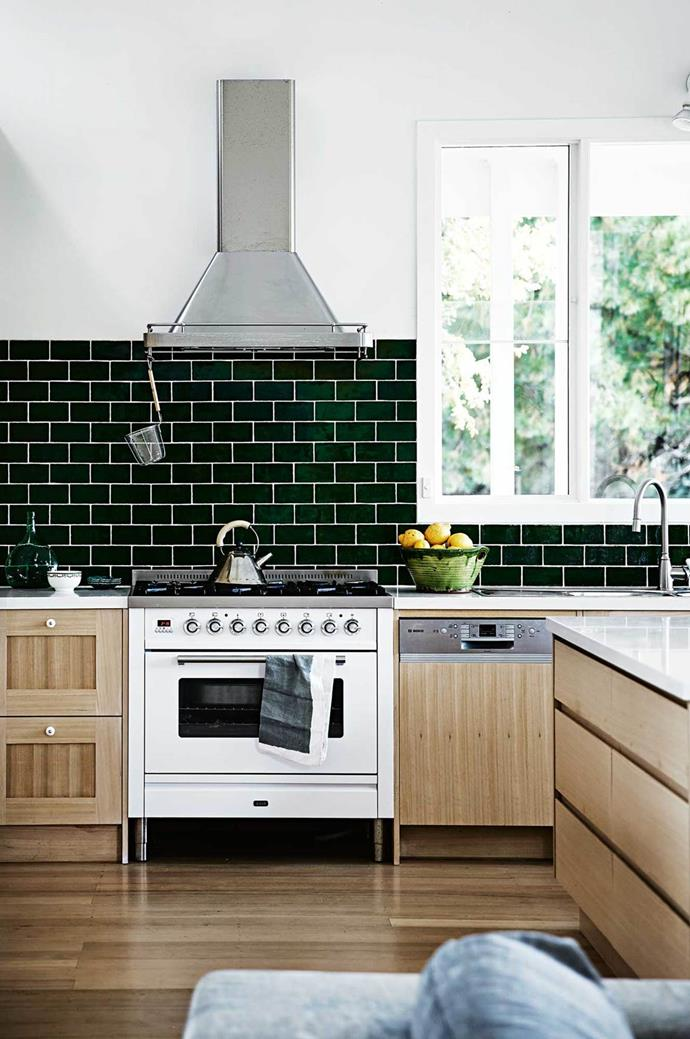 "Deep green splashback subway tiles create visual interest in this [weatherboard home's](https://www.homestolove.com.au/a-light-filled-farmhouse-on-the-mornington-peninsula-13833|target=""_blank"") country kitchen  in the Mornington Peninsula."