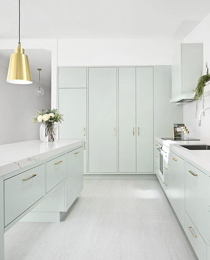 "Striving for an 'un-kitcheny' kitchen was the starting point for this dreamy [designer space](https://www.homestolove.com.au/pastel-green-kitchen-by-three-birds-renovations-5209|target=""_blank""). ""We wanted a white-based stone that looked like marble. The Statuario Nuvo won our vote because its white base is quite creamy, which we knew would work in harmony with the pale-green cabinetry,"" explains designer Lana Taylor of Three Birds Renovations."