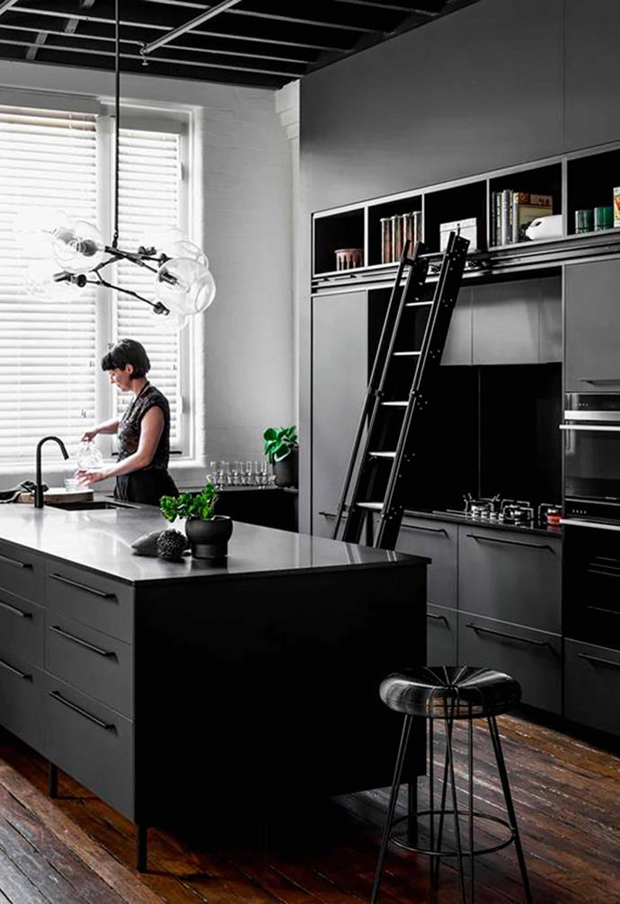 "Beautiful Bengal Black honed granite sings in the kitchen of this [converted warehouse in Brisbane](https://www.homestolove.com.au/historic-warehouse-turned-industrial-apartment-19973|target=""_blank"")."
