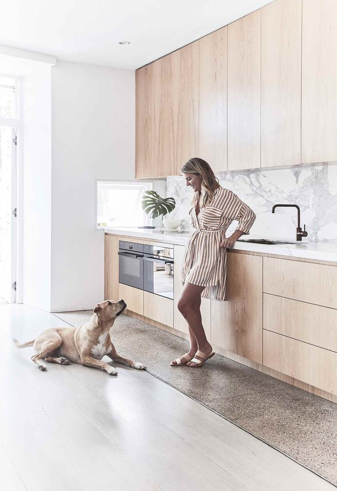 "In this [sun-drenched Bondi home](https://www.homestolove.com.au/duplex-home-renovation-19533|target=""_blank"") a marble benchtop is complemented with a matching marble splashback and timber cabinetry."