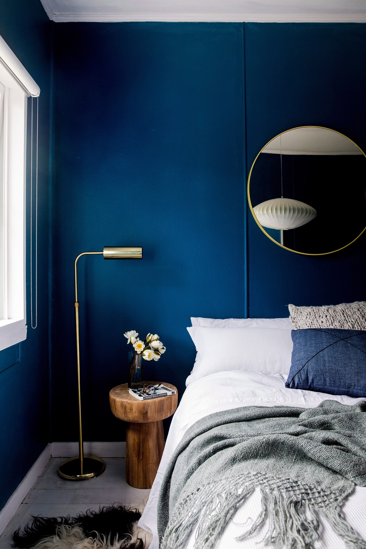 """Mix different textures like sumptuous linen and natural leather with dramatic dark walls for a [dreamy bedroom space](http://www.homestolove.com.au/dreamy-bedroom-accessories-2318