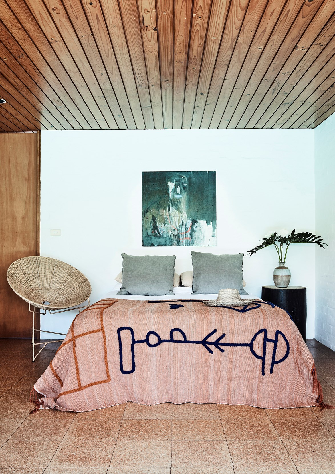 Less is more in the master bedroom of this modernist home in Sydney.