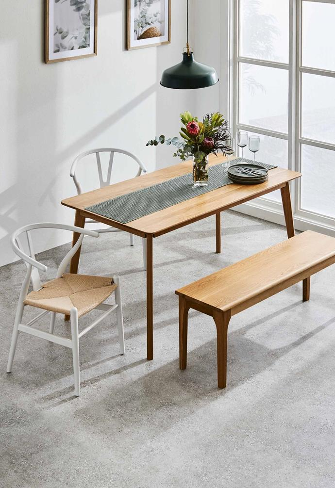The dining range includes a striking solid American oak dining table and bench.