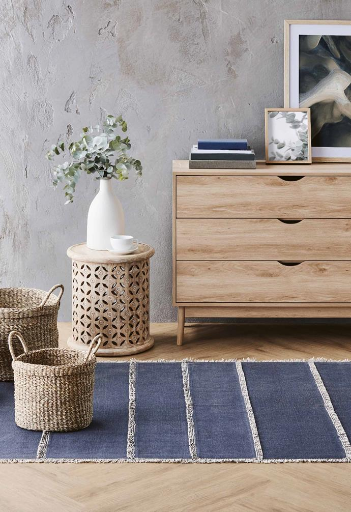 """**Bedroom** Chest of 3 drawers in natural or white, $99.99, decorative storage baskets, $19.99, Carved mango wood side table, $79.99, Woven area rug, $59.99, [Aldi Australia](https://www.aldi.com.au/en/special-buys/ target=""""_blank"""" rel=""""nofollow"""")."""