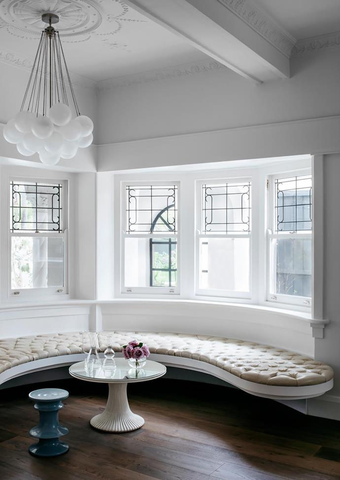 Kathryn Robson and Chris Rak of Robson Rak custom designed the leather banquette which hugs the room's curves. Chris also designed the stool; the table is from Nicholas & Alistair. The circular patterns etched in the ceiling cascade towards the floor in the form of another Apparatus 'Cloud' pendant light.
