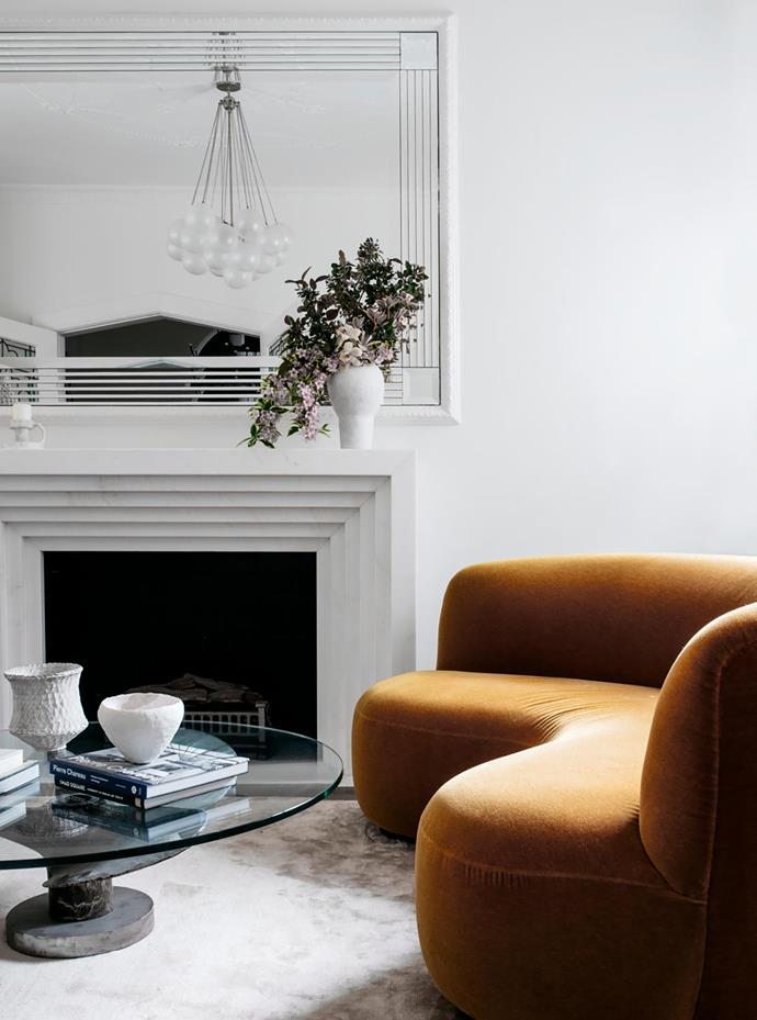 Kathryn and Chris refurbished the mirror and designed the marble fireplace in recurring geometric lines that create a visual dialogue reminiscent of the 1920s.