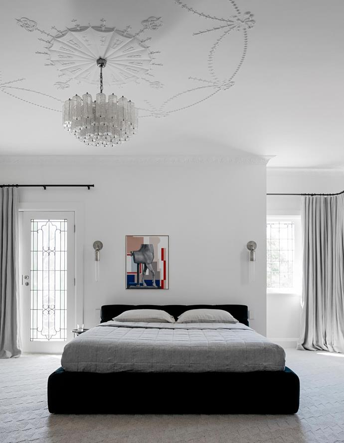 Luxuriant textiles and shades of grey reign in the master bedroom. On the B&B Italia 'Tufty' bed from Space is a Southwood quilt; a chandelier from Nicholas & Alistair descends like a stalactite. The carpet is Halcyon Lake and the Mokum linen curtains are by In Vogue Blinds. On the wall are Apparatus 'Tassel' sconces and a Genevieve Felix Reynolds artwork from Nicholas Thompson Gallery.