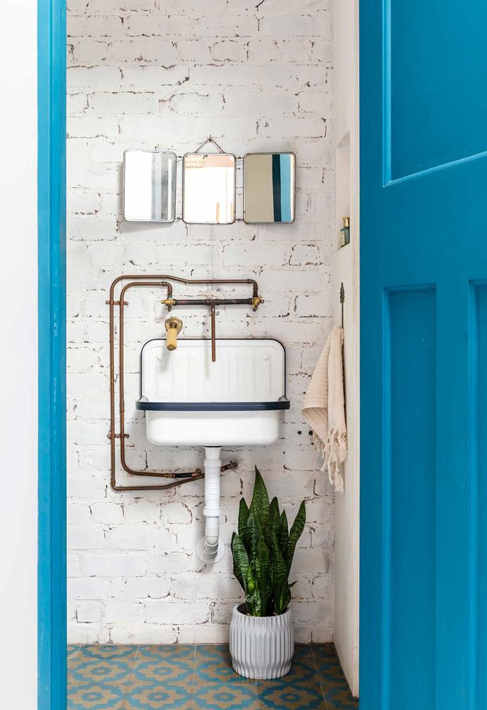 **Bathroom** Copper piping gives the room a vintage industrial look. The mirror is another retro find.