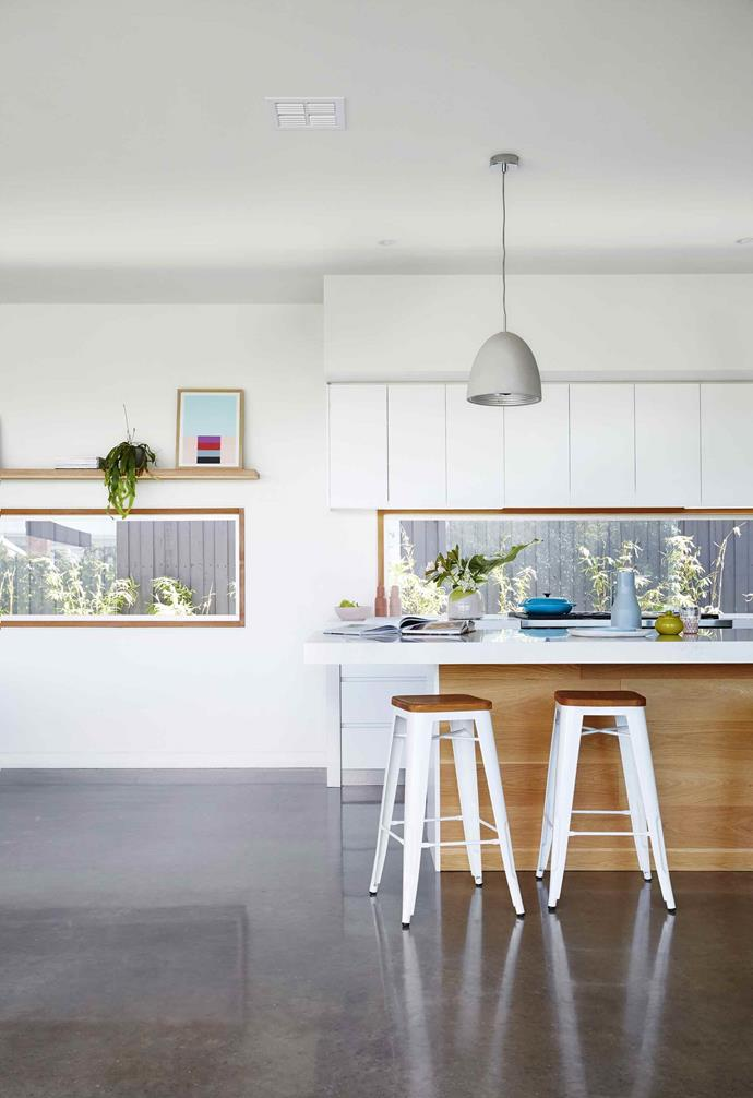 """Concrete and timber material choices lay at the heart of the design of this [contemporary beach house in Torquay](https://www.homestolove.com.au/contemporary-beach-house-torquay-17256