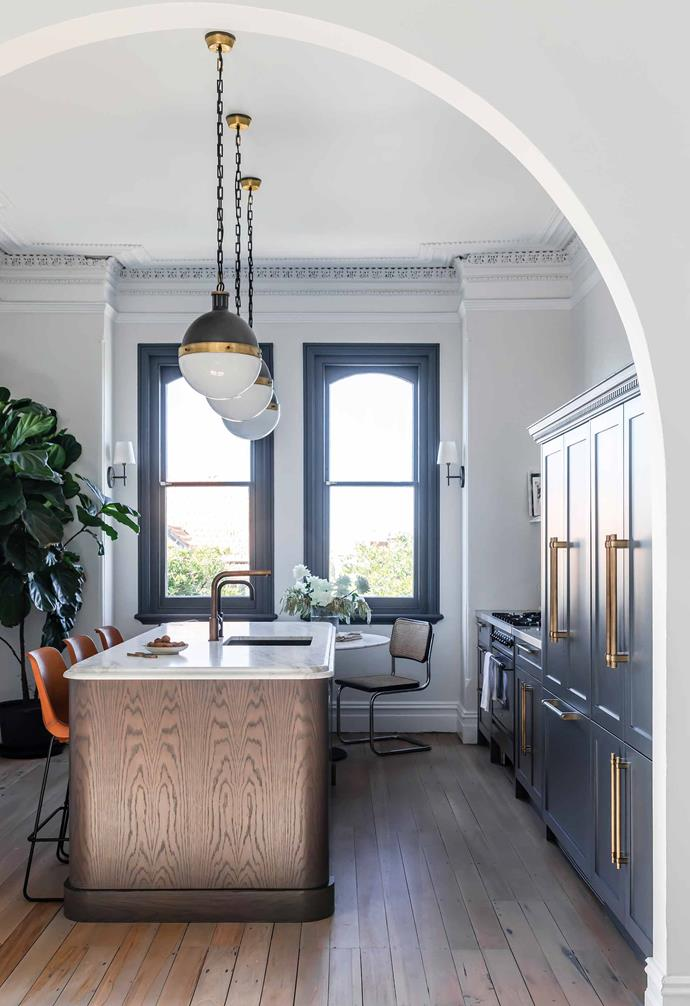 """The spherical shape of the pendant lights chosen for the kitchen in interior designer [Jillian Dinkel's Federation home](https://www.homestolove.com.au/jillian-dinkel-home-21167