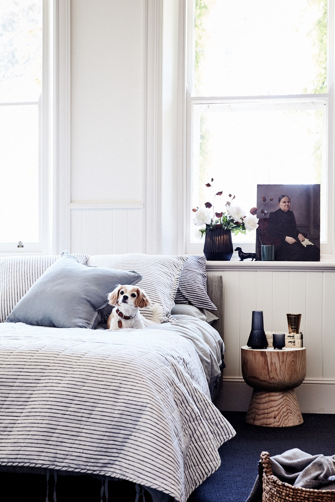 A place to pop your tea down, a puppy dog to cuddle and plump euro cushions to prop yourself up to read a book or the paper - this bedroom ticks all the boxes in terms of comfort and style.