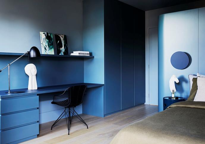 Dulux 'Kolya' paint and custom furniture set the tone in this bedroom. Linens from In Bed and Cultiver and cushions from MCM House adorn the Fanuli 'Bun' bed. Beside it is a 'Componibili 3' unit by Kartell and a 'Polar' wall light by Ross Gardam. On the desktop is a Fanuli 'Shore' table lamp, a ceramic Dreamer 9 sculpture by Kristiina Haataja and, on the shelf, are artworks by Amanda Schunker titled Breaking Through 1 and 2. Overgaard & Dyrman 'Wire' chair.