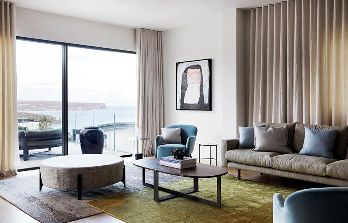 Mokum curtains and rugs from The Rug Establishment. The furnishings take their cues from the view, including the green Jardan 'Errol' sofa and blue Molteni&C armchairs by Gio Ponti. Molteni&C 'Domino Next' coffee table by Nicola Gallizia. The 'Oscar' ottoman is from Fanuli and the artwork on the wall is I'm With You by Antonia Mrljak.