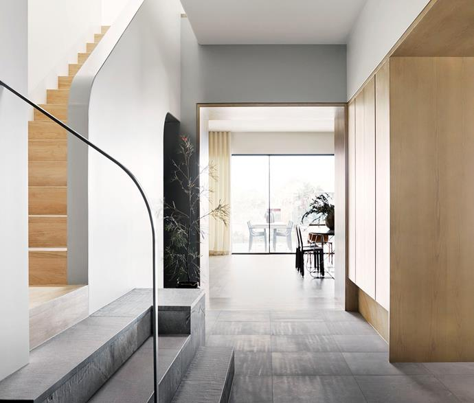 Sporting a sandblasted and leathered finish, the marble floor tiles pour into the sensorially immersive entry, its ceilings and walls painted in Dulux 'Sailing Safari'.