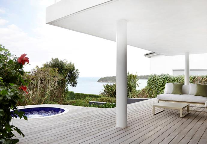 The outdoor deck, hot tub and overhead balcony were rebuilt during the renovation. The raw spotted-gum decking feels harmonious against the surrounding garden, as does the Gandia Blasco 'Flat' sofa and low table from Hub.