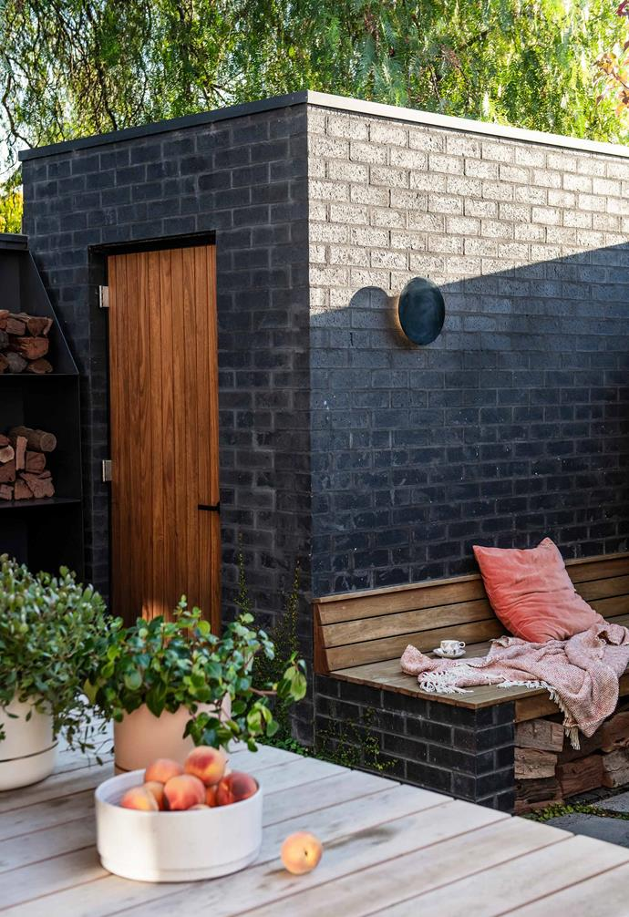 "A brick utility shed keeps garden clutter out of sight while offering support for seating. The bench is Silvertop ash from [Radial Timbers](https://radialtimbers.com.au/|target=""_blank""