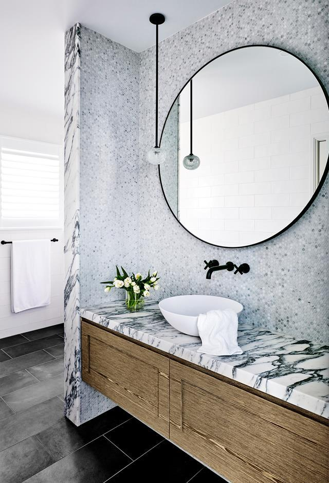 """""""Our approach was to hide all functional aspects of the bathroom (shower, WC, linen press) so that the glamorous vanity became the focus,"""" says designed Suzanne Gorman of Studio Gorman. It features a Arabescato marble benchtop from CDK Stone with Eveneer 'Saltwood' veneer cabinetry."""