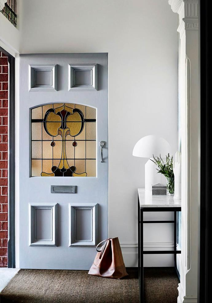 Powder blue makes a soft statement combined with the original leadlight on the door of this classic Edwardian home.