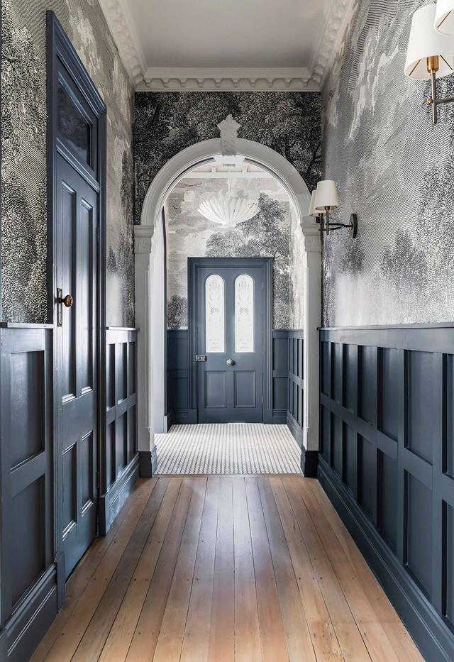 "Mural-style Etched Arcadia wallpaper from Anthropologie in this [charming Federation home](https://www.homestolove.com.au/jillian-dinkel-home-21167|target=""_blank"") has been used throughout the hallway to the entryway's calming blue front door."