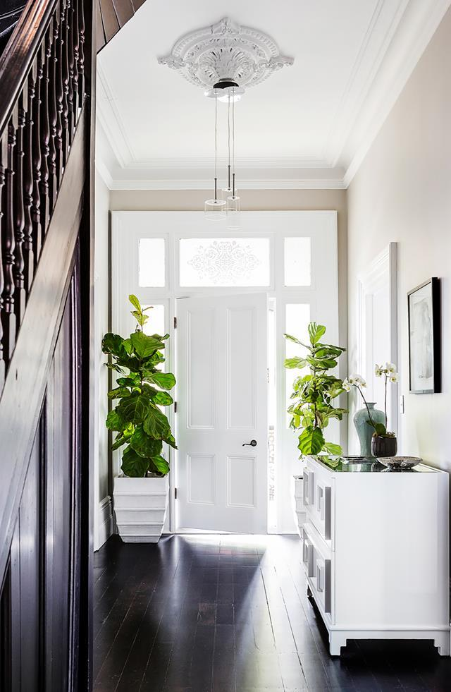 "The devil is in the detail for interior designer Brendan Wong who finessed this [1890s home](https://www.homestolove.com.au/grand-victorian-terrace-updated-with-contemporary-furnishings-21112|target=""_blank"") into a modern gem. Black Japan floors in the hallway lead to the white front door where the framing floods light into the entrway."