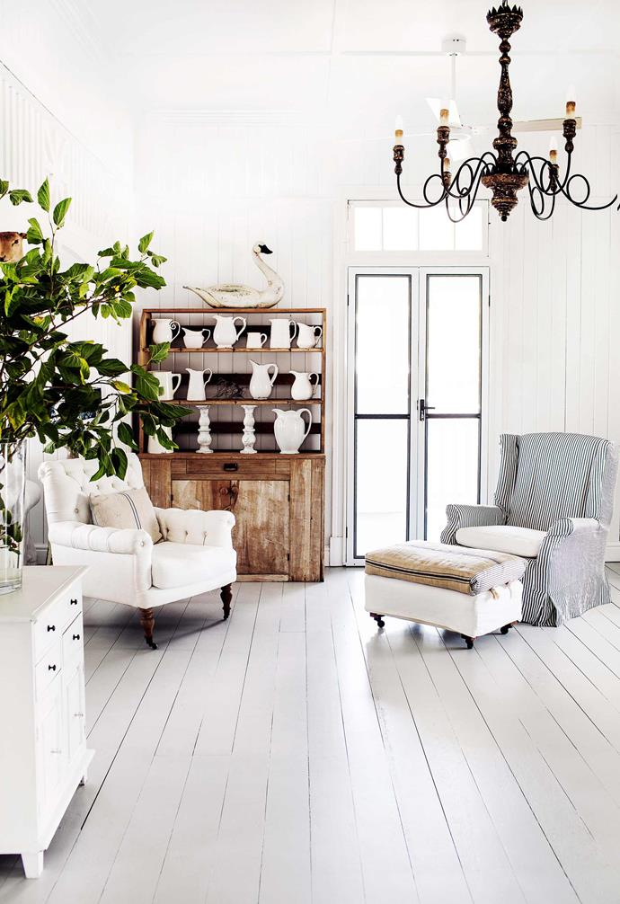"For those that can't get enough of the [clean and crisp all-white look](https://www.homestolove.com.au/white-interiors-8517|target=""_blank""), white timber flooring has become a major trend. In this [Bundaberg Queenslander](https://www.homestolove.com.au/queenslander-white-interior-colour-scheme-19786