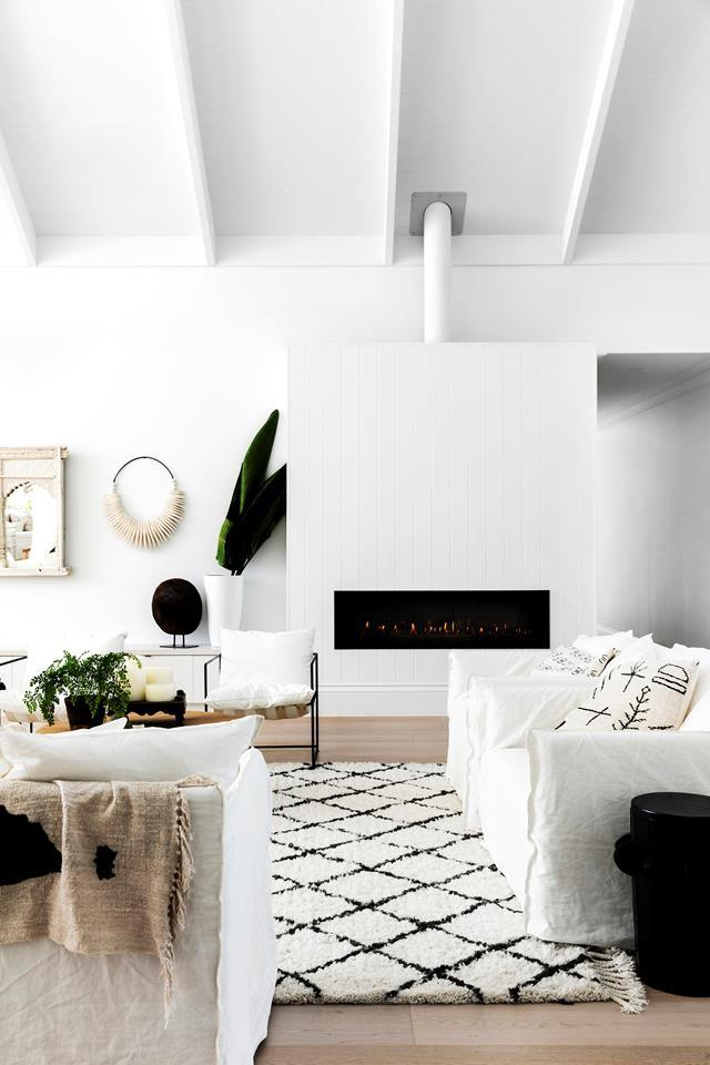"Bonnie Hindmarsh's eclectic aesthetic is on display at her [modern-coastal home](https://www.homestolove.com.au/three-birds-bonnie-hindmarshs-modern-coastal-home-6802|target=""_blank"") showcasing how a black and white palette needn't be boring. Various layers, textures and patterns culminate to create a visually interesting space."