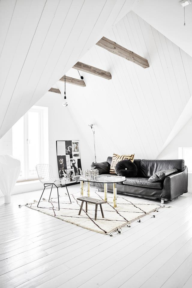 "A [Swedish home](https://www.homestolove.com.au/a-rustic-home-with-vintage-industrial-style-4646|target=""_blank"") is opened up, painted white, filled with unique finds and deliberately unfinished for a raw and rustic vibe. ""I prefer soft schemes with graphic elements of black and white, occasionally with a bit of colour,"" says owner Josephine Ekström."