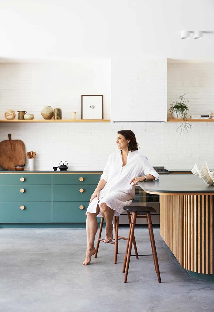 **Kitchen** Melissa in holiday mode. The standout element of the cooking zone is the green-and-timber combination, carried through joinery and island.