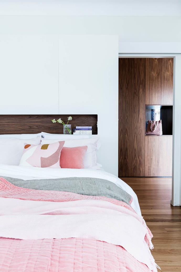 "Custom joinery in this [bedroom](https://www.homestolove.com.au/1940s-facade-hides-a-sizzling-21st-century-home-3269|target=""_blank"") creates a functional display as well as plenty of hidden storage."
