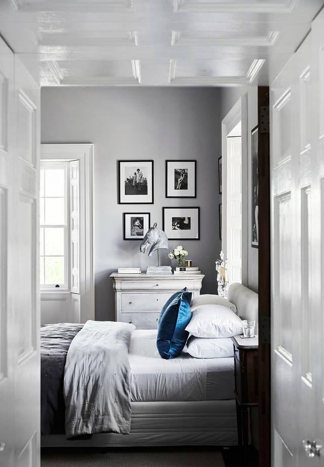 "Work within a colour palette and add statement finishes to create interest. The silver and white palette in this [elegant bedroom](https://www.homestolove.com.au/restoration-of-a-historic-sydney-home-6524|target=""_blank"") is a lighter take on a classic monochrome scheme."